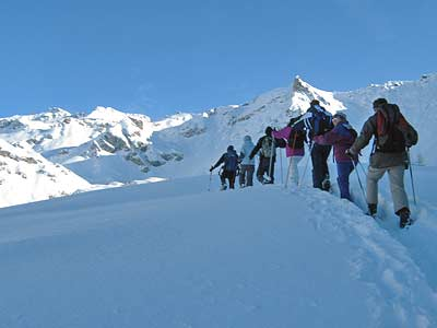 Ski mountaineering at high altitude in the Chamois Area in winter
