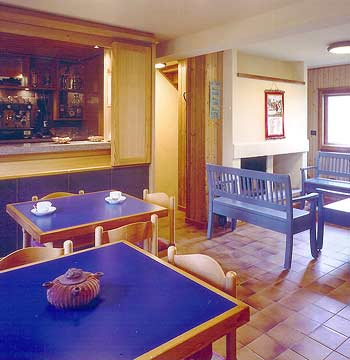 Inner view of the living room in the Rifugio L'Ermitage