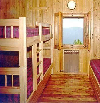 Inner view of a bedroom in the Rifugio L'Ermitage